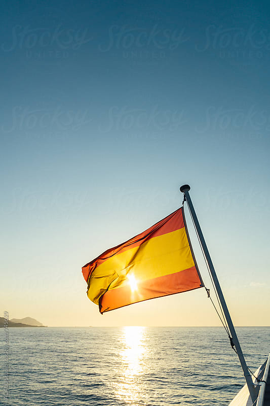 Spanish flag at sea by ACALU Studio for Stocksy United