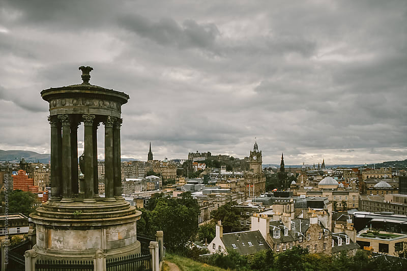 dramatic sky over Edinburgh by Leander Nardin for Stocksy United