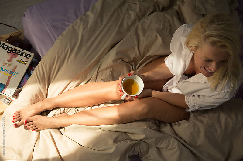 Woman Drinking Morning Tea on Her Bed by Lumina for Stocksy United