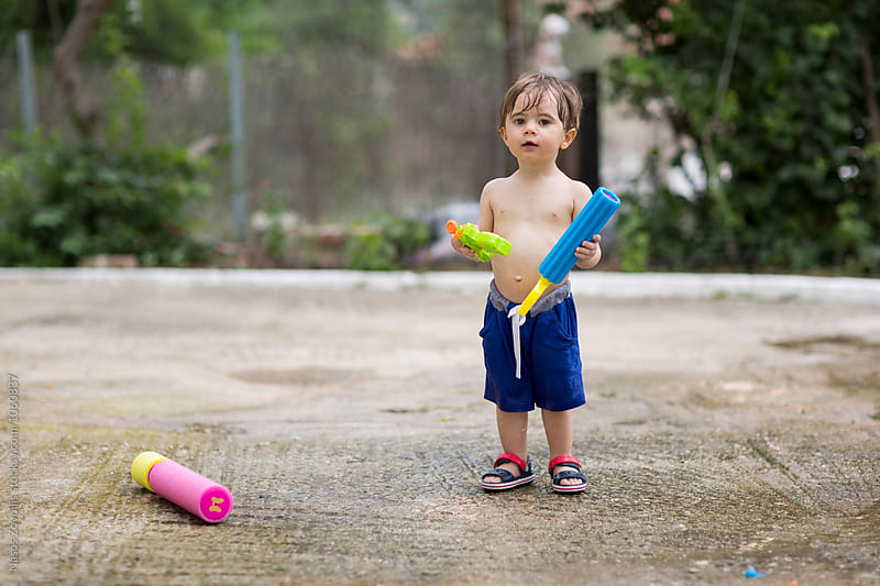 1 year old boy playing outdoor by Nasos Zovoilis for Stocksy United