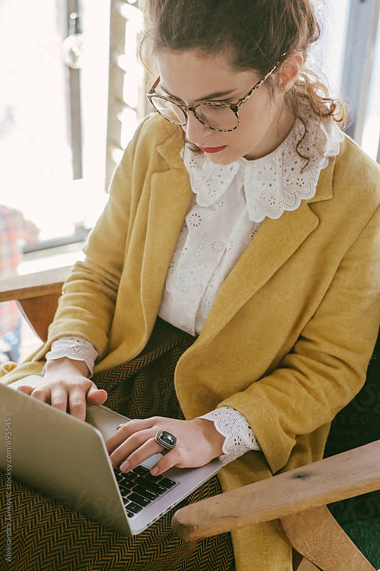 Young Stylish Woman with Glasses Working on Laptop by Aleksandra Jankovic for Stocksy United