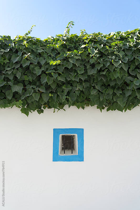 Small window of a typical house Ibiza by ACALU Studio for Stocksy United