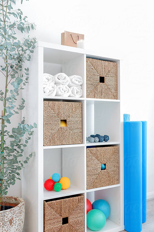 Corner of a Pilates studio with unit storing various items used for exercise by Paul Phillips for Stocksy United