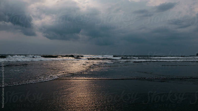 Dark and Moody Sunset on Echo Beach in Bali by Nemanja Glumac for Stocksy United