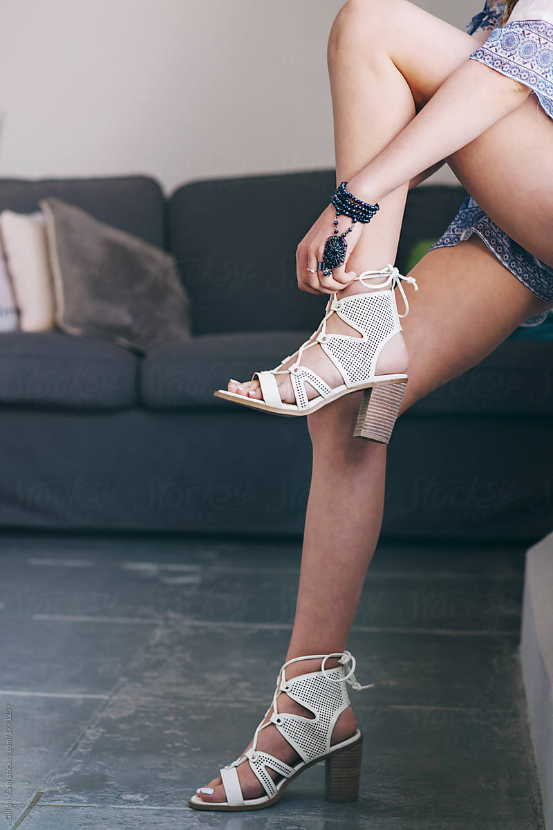 1501afe823c7 teen putting on high heel sandals by Gillian Vann for Stocksy United