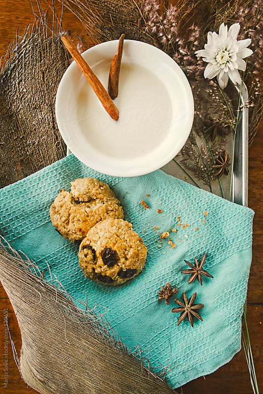 Milk with cinnamon and oat cookies served on table.   by Marija Savic for Stocksy United