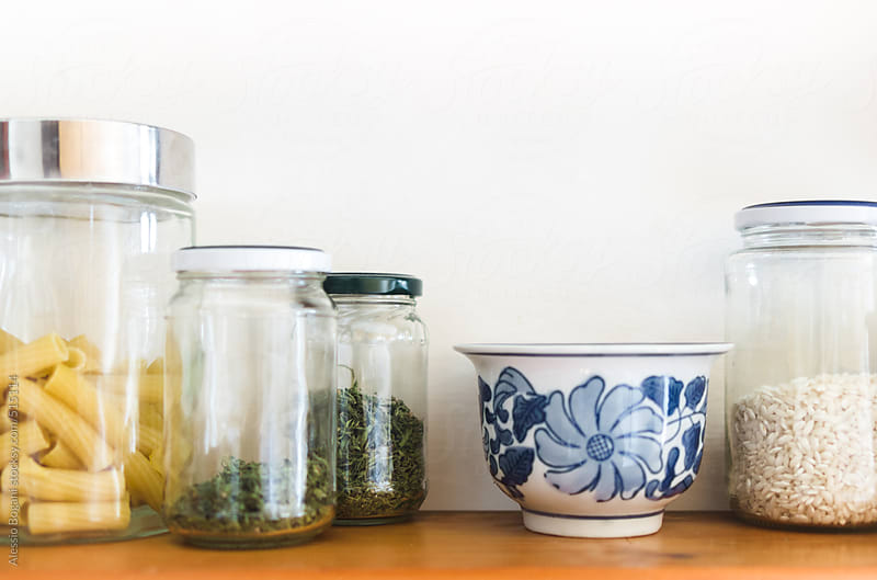 Pantry kitchen shelf with jarred food by Alessio Bogani for Stocksy United