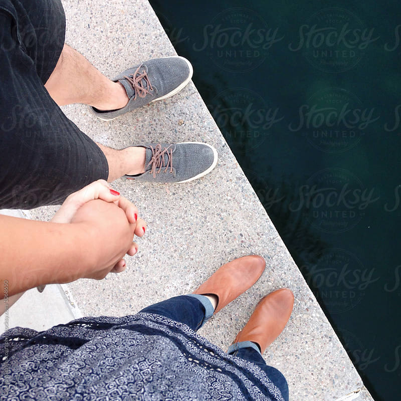 Couple holding hands by Daniel Kim Photography for Stocksy United