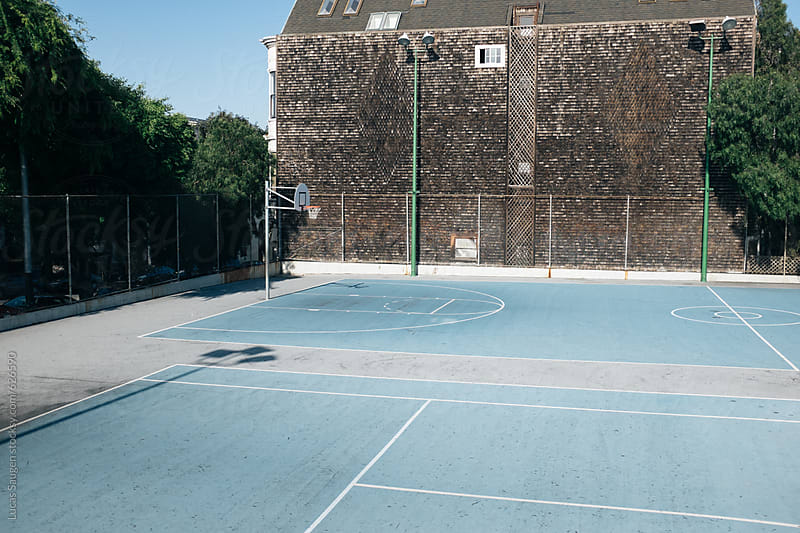 Empty urban basketball court by Lucas Saugen for Stocksy United