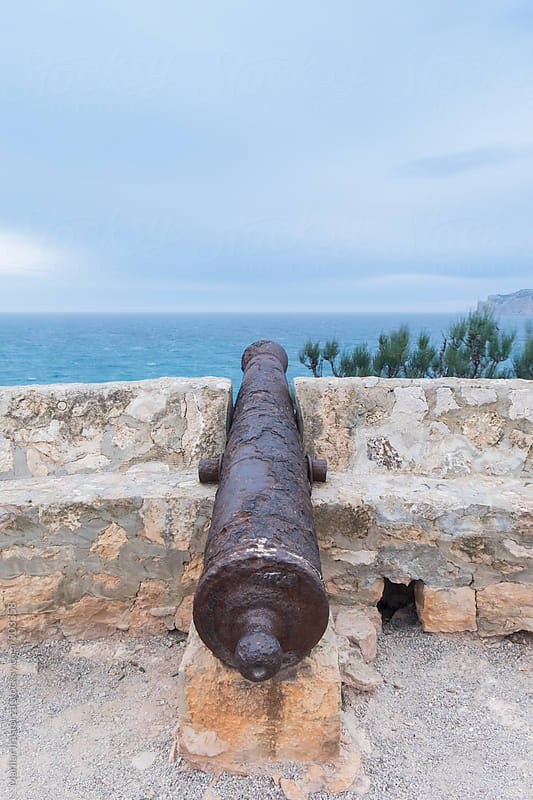Old cannon pointing toward the Mediterranean Sea by Marilar Irastorza for Stocksy United