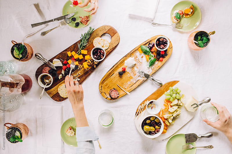 Cocktails and Appetizers  by Cameron Whitman for Stocksy United