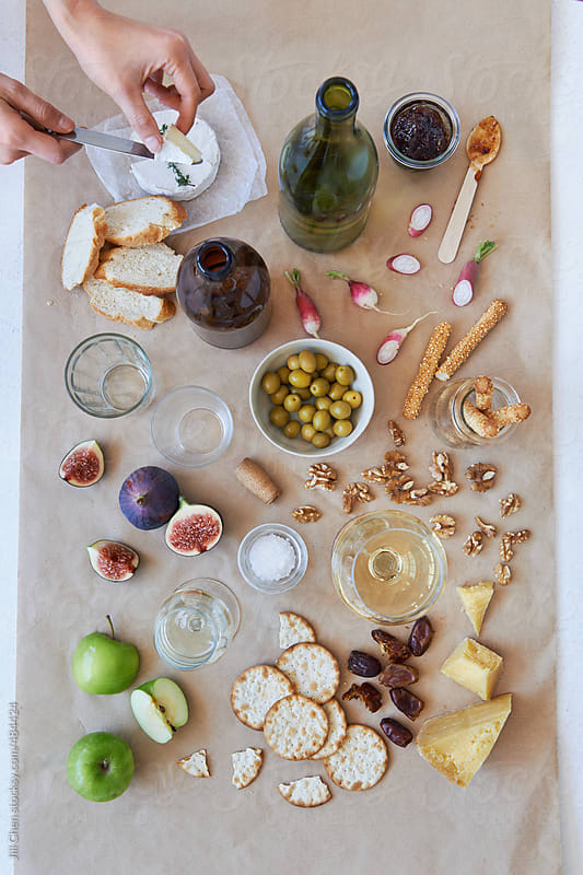 Party cheese snacks laid out shot overhead by Jill Chen for Stocksy United
