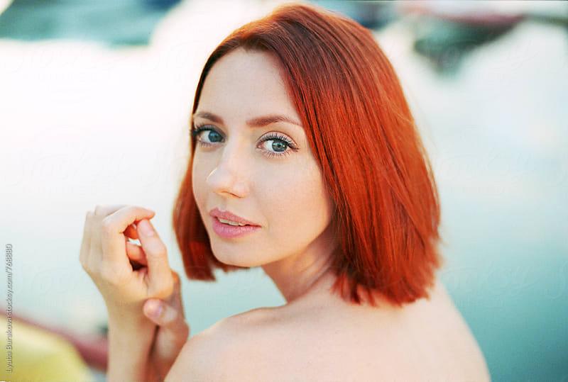 Portrait of a redhead woman by Lyuba Burakova for Stocksy United