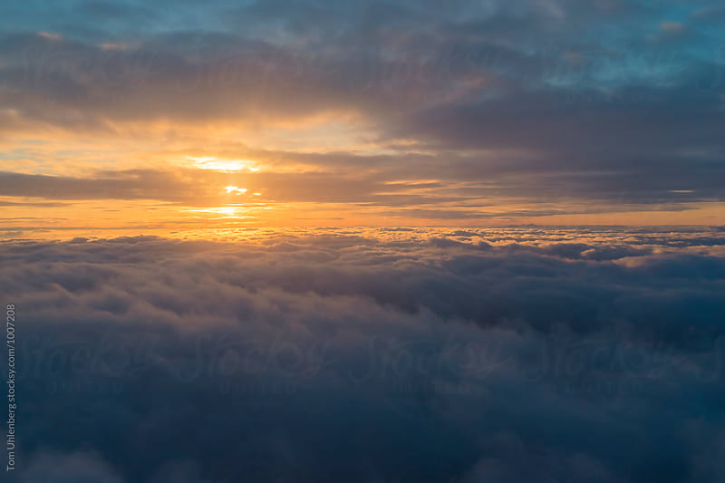 Sunset over Clouds by Tom Uhlenberg for Stocksy United