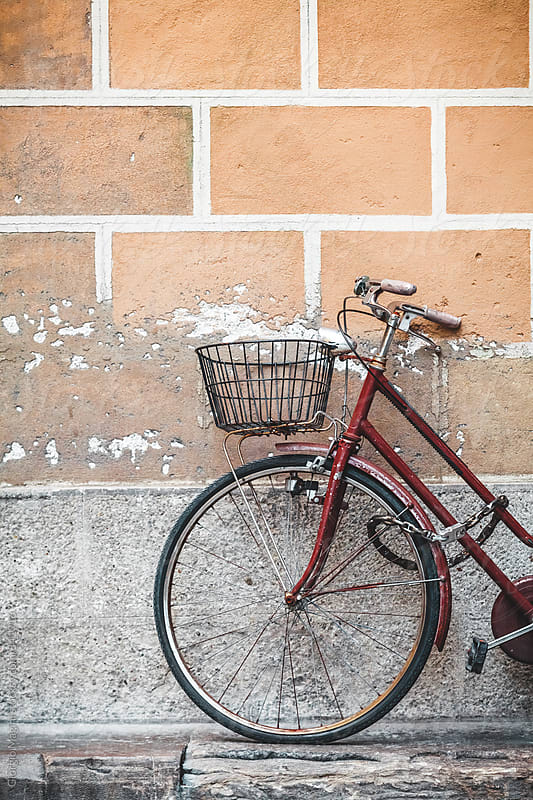 Retro Bicycle Leaning on a Grungy Wall in Italy by Giorgio Magini for Stocksy United