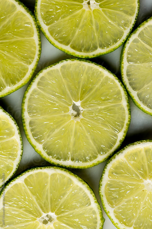 Cut Slices of Lime in Closeup by Jeff Wasserman for Stocksy United