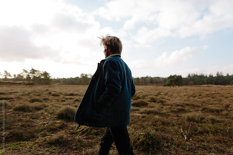Man walking in nature by Denni Van Huis for Stocksy United