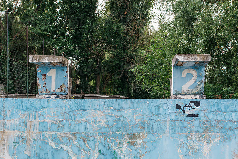 Jumping blocks on an old derelict swimming pool by Gabriel (Gabi) Bucataru for Stocksy United