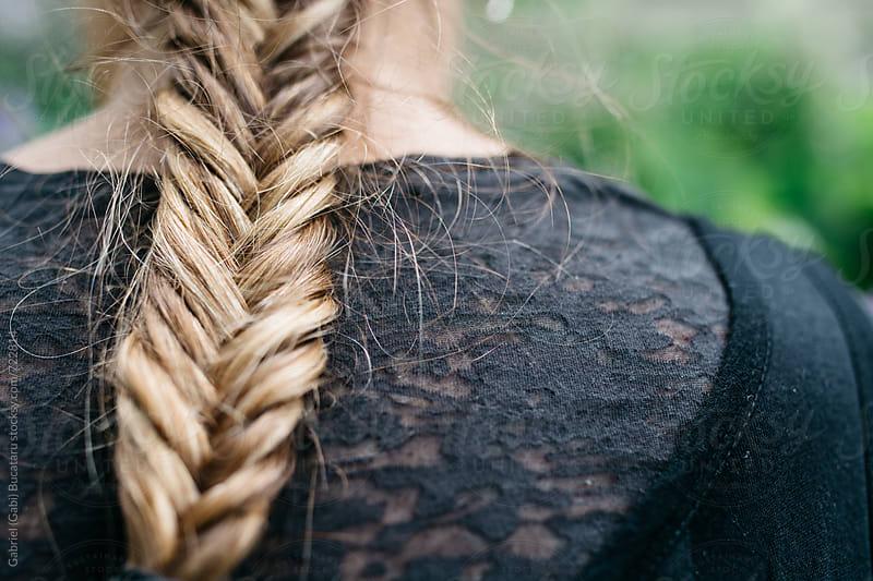 Braided hair of a woman by Gabriel (Gabi) Bucataru for Stocksy United