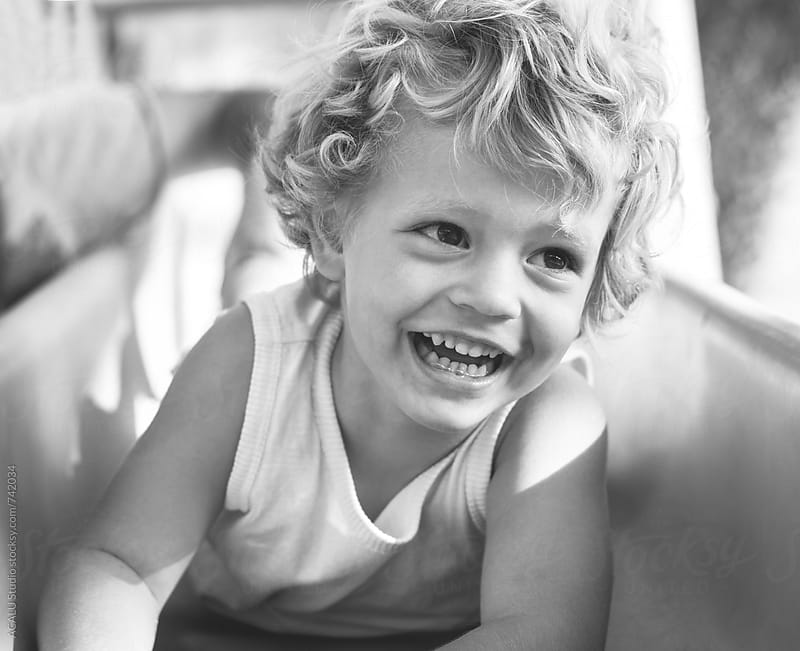 Little boy smiling happily by ACALU Studio for Stocksy United