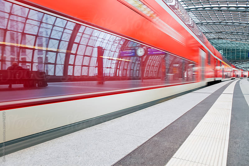Europe, Germany, Berlin, new modern main railway station  - train pulling into the platform by Gavin Hellier for Stocksy United