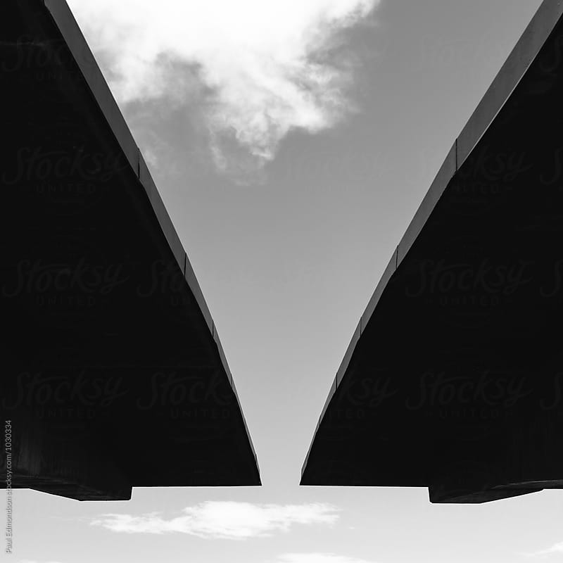 Modern roof from highway rest stop, sky and clouds above by Paul Edmondson for Stocksy United