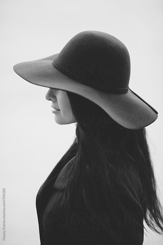 woman with hat by Alexey Kuzma for Stocksy United