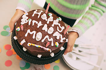 Child Has Decorated Homemade Birthday Cake For Mom