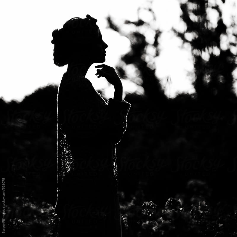 Silhouette Of A young girl in a field by Sergey Filimonov for Stocksy United