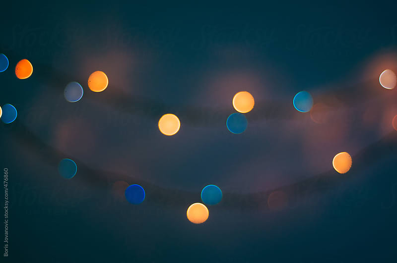 Out of focus Christmas bulb lights by Boris Jovanovic for Stocksy United
