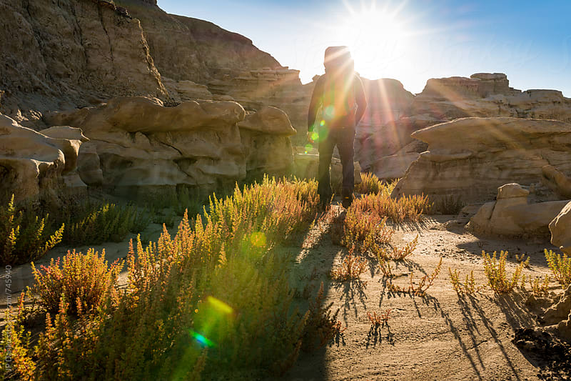 Hiking in Bisti Badlands Wilderness Area New Mexico at Sunrise to Camp Site by JP Danko for Stocksy United
