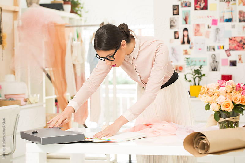 Fashion Designer Sketching at Her Studio by Lumina for Stocksy United