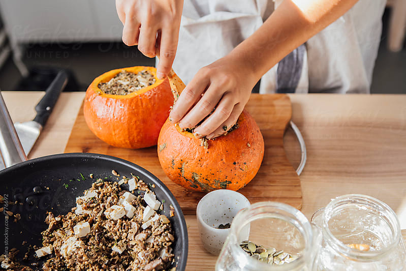 Woman Fills Pumpkins With Mushrooms  by Lumina for Stocksy United