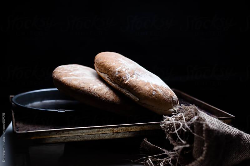 Freshly baked bread. by Darren Muir for Stocksy United