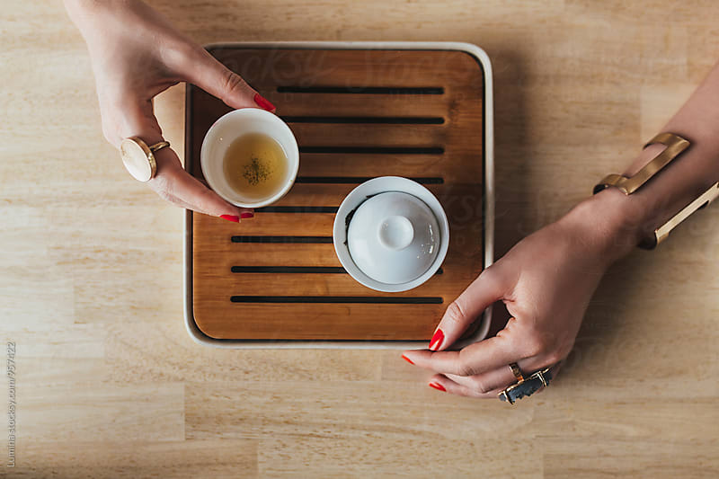 Caucasian Woman Drinks Tea by Lumina for Stocksy United