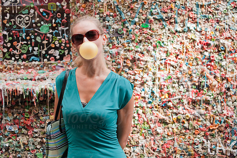 Woman blowing bubble with sunglasses by Andersen Ross Photography for Stocksy United