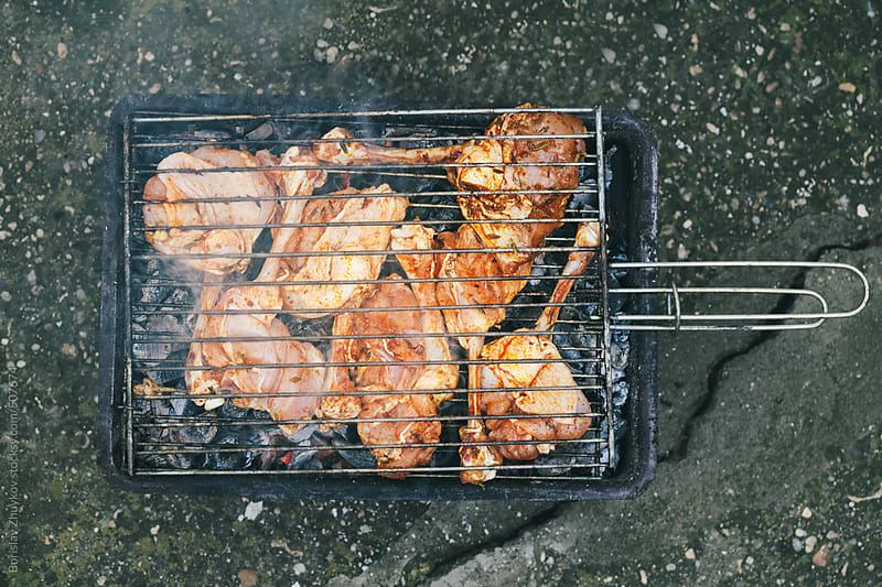 Seasoned Raw Chicken Legs On The Grill From Above by Borislav Zhuykov for Stocksy United