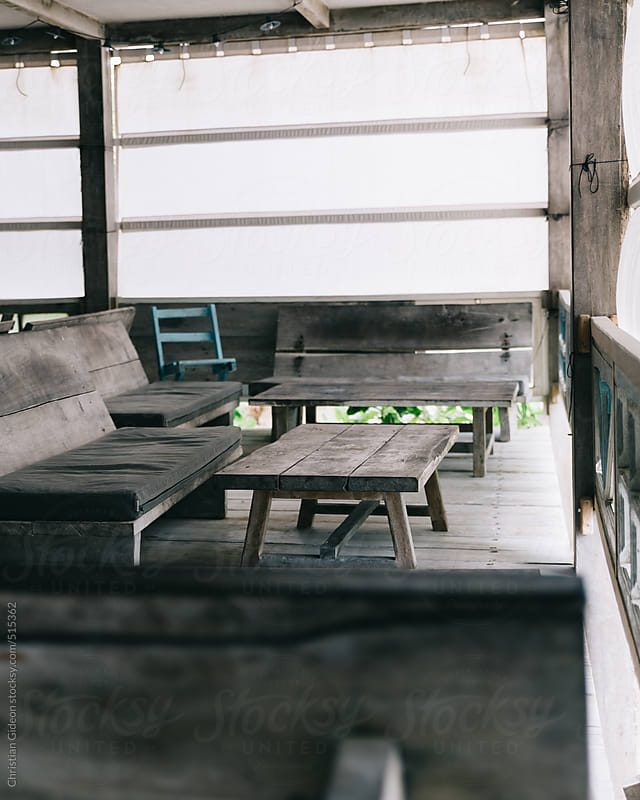 Rustic wooden tables by Christian Gideon for Stocksy United