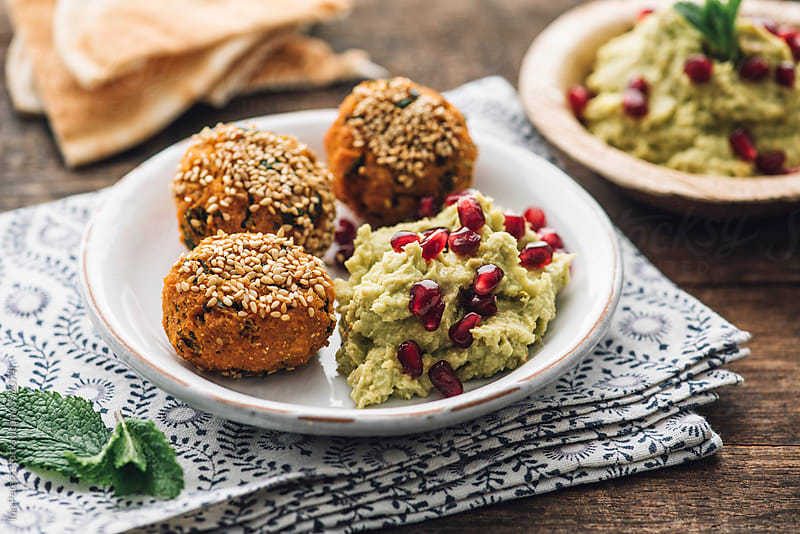 Food: Sweetpotato and Chickpea Falafel with Avocado Hummus by Ina Peters for Stocksy United