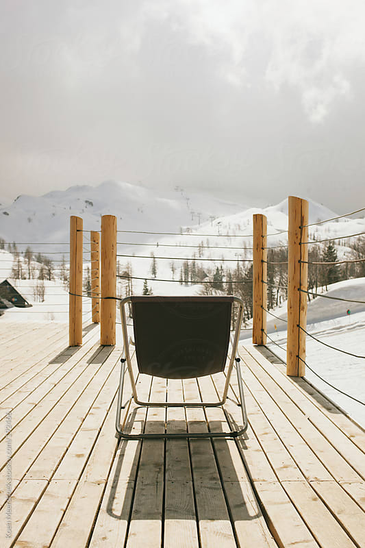 One sun bed on a terrace in a ski area. by Koen Meershoek for Stocksy United