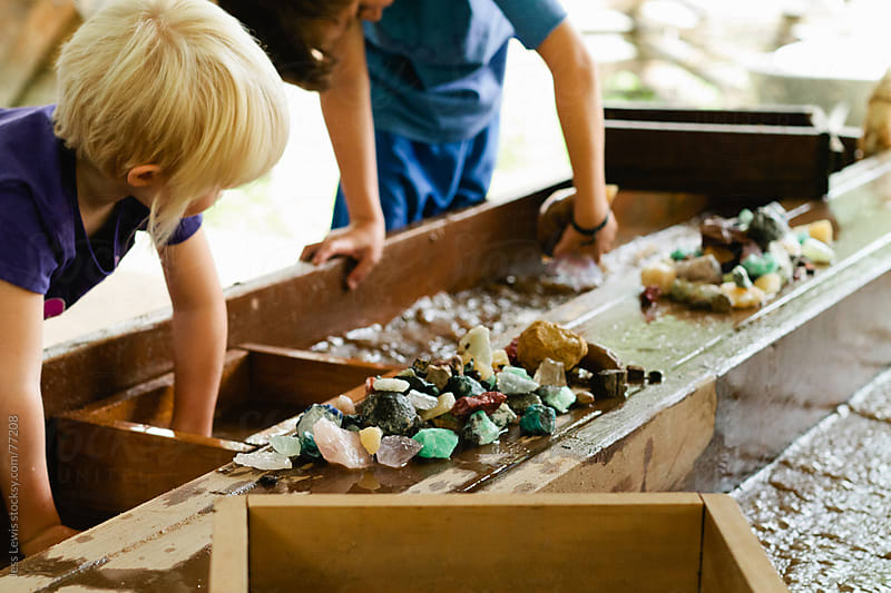 children mining for gemstones by Jess Lewis for Stocksy United