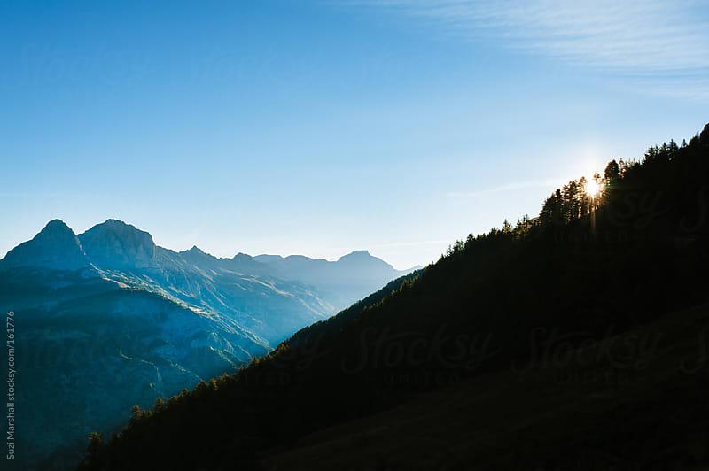 Sunrise over a mountain range by Suzi Marshall for Stocksy United