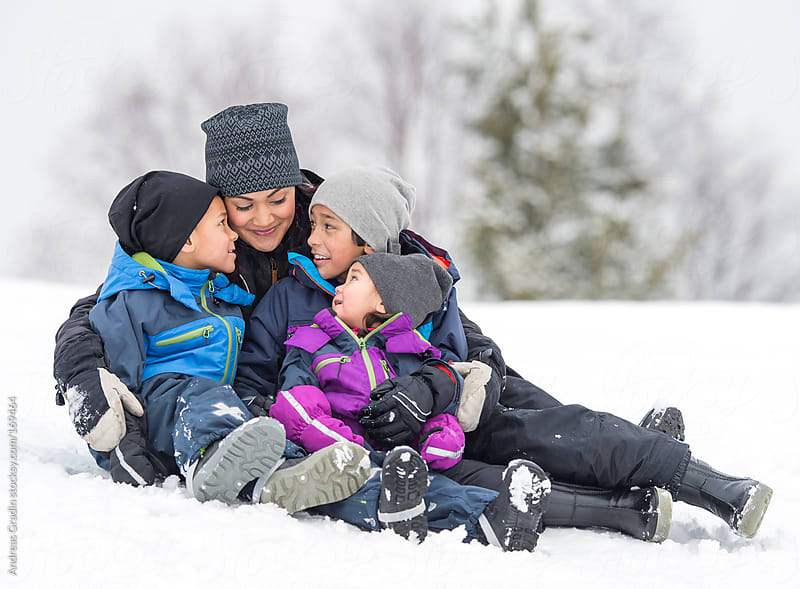 winter family fun by Andreas Gradin for Stocksy United