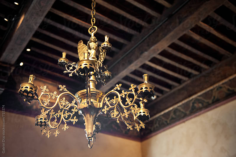 Chandelier in old house.  by Gabriel Diaz for Stocksy United