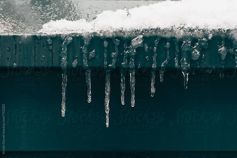 Close up of icicles by Kristin Duvall for Stocksy United