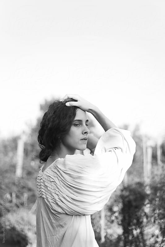 Portrait of a beautiful woman outdoors on a sunny day. Black and white by Marija Mandic for Stocksy United