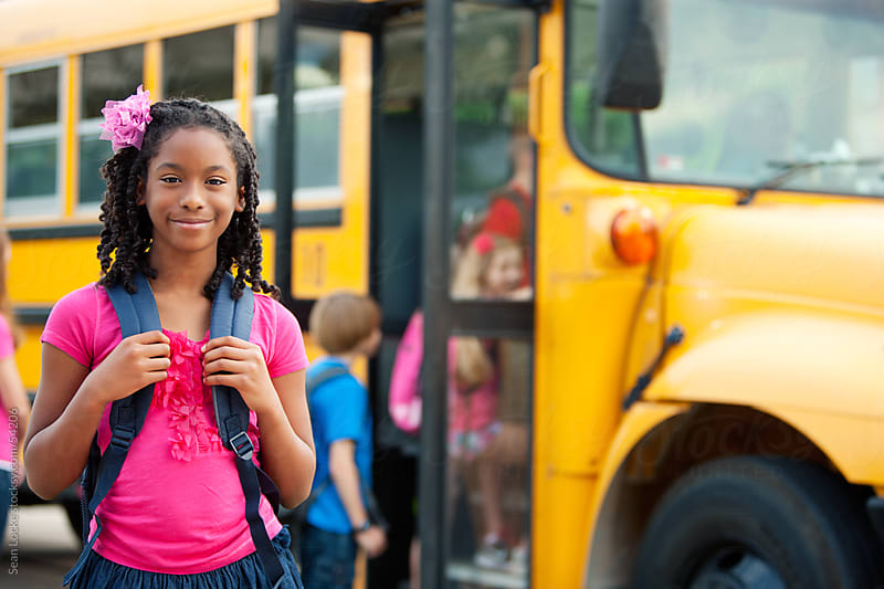 School Bus: Cute Girl Ready for School by Sean Locke for Stocksy United