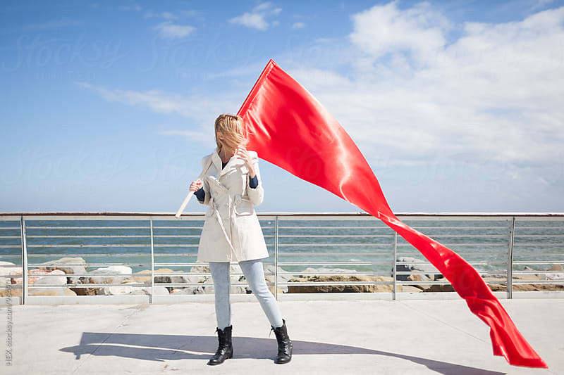 Woman With red Flag by HEX. for Stocksy United