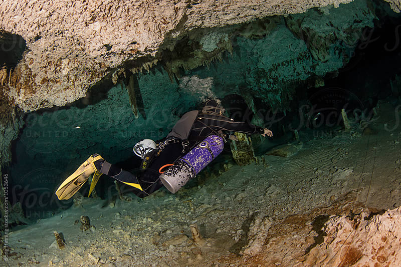 A scuba diver swimming in Mexico's  Cenote  Dos Ojos by Song Heming for Stocksy United