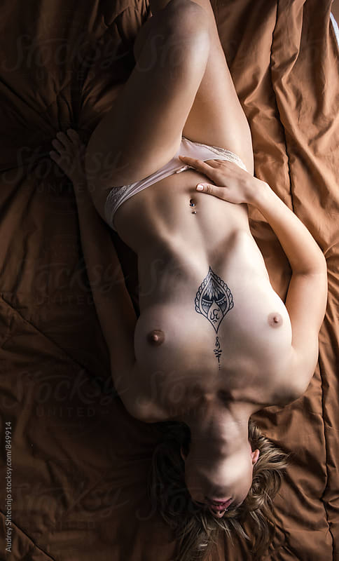 Sensual nude blonde female in bed. by Audrey Shtecinjo for Stocksy United
